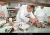 paris-france-haute-cuisine-restaurant-kitchen-with-chef-and-owner-ak6ce0