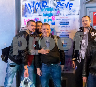 """Paris, France, PrEP, HIV Prevention Activists putting up Protest posters in the Marais Neighborhood """"Free PrEP Now"""""""
