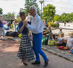 Paris, France, Senior Adults Picknicking and Dancing on the Seine RIver Quay